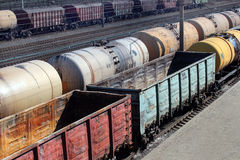 Tanks with fuel and cargo carriages on freight railway station Stock Image