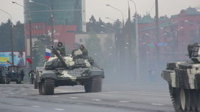 Tanks, military army invasion of the city, armored troop-carrier, danger, smoke. Russian army, special car transports Battle Tank stock video footage