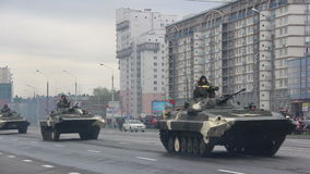 Tanks, military army invasion of the city, armored troop-carrier, danger, smoke. Russian army, special car transports Battle Tank stock video