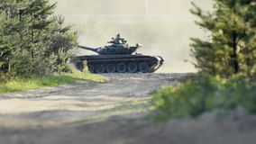 Tanks moving on the road through the forest stock video footage