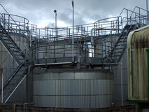 Tanks and rails. Fuel storage tanks and access platforms Royalty Free Stock Photo