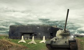 Tanks T-34 in front of Czechoslovak border fortifications with the Czech hedgehogs and damaged self-propelled gun ISU royalty free stock photography