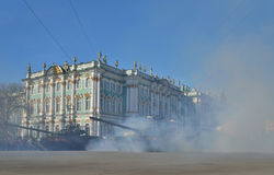 Tanks T-90 with a red flag in a puff of smoke at the Palace squa Stock Photography