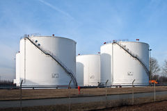 tanks in tank farm with blue sky Stock Photo
