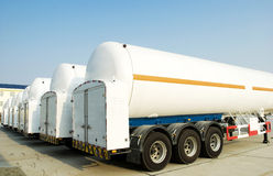 Tanks under blue sky. Tanks for oil or natural gas in trucks Royalty Free Stock Photography
