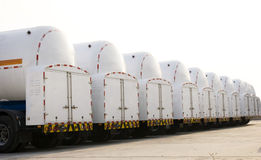 Tanks under blue sky. Tanks for oil or natural gas in trucks Royalty Free Stock Images