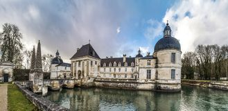 Tanlay castle panoramic view, spring day, cloudy weather, France Royalty Free Stock Images