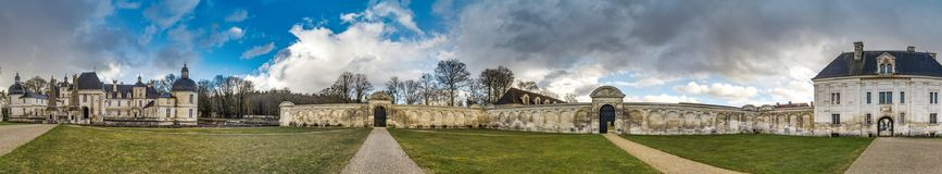Tanlay castle panoramic view, spring day, cloudy weather, France Royalty Free Stock Photo