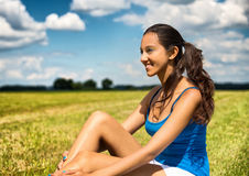 Tanned beautiful young woman in a field Royalty Free Stock Photography