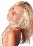 Tanned blond girl. Portrait of a beautiful tanned blond girl, white background Royalty Free Stock Photography