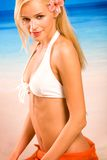 Tanned blond woman in bikini stock photos