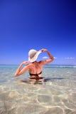 Tanned blond woman in bikini in the sea stock photo