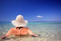 Tanned blond woman in bikini in the sea stock photos