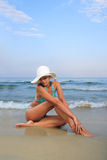 Tanned blond woman in bikini in the sea Stock Photos