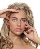 Tanned blond woman with long hair Royalty Free Stock Images