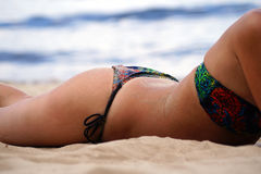 Tanned body on the sand.  stock photo