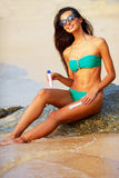 Tanned brunette on the beach Stock Photos