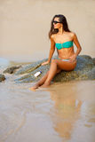 Tanned brunette on the beach Royalty Free Stock Photos
