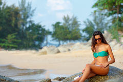 Tanned brunette on the beach Royalty Free Stock Images