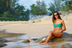 Tanned brunette on the beach Stock Image