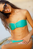 Tanned brunette on the beach Stock Photo