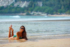 Tanned brunette laying on the beach Royalty Free Stock Photo