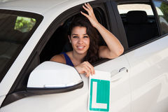 Tanned brunette with learner plate in white car Stock Photo