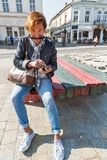 Woman tourist use smartphone in Kosice Old Town, Slovakia. royalty free stock photo