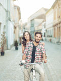 Tanned couple having fun on the bike Stock Image