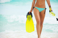 Tanned female body on sea background Stock Image