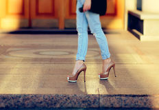 Tanned female legs in heels.  royalty free stock images