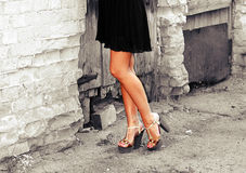 Tanned female legs in heels.  Royalty Free Stock Photos