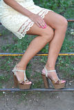Tanned female legs in heels Stock Photos