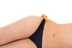 Tanned female stomach and legs Stock Photography