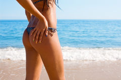 Tanned figure girl and sea Stock Images