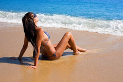 Tanned girl at beach Stock Images