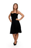 Tanned girl in a black dress Royalty Free Stock Photo