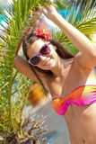 Tanned girl near the palm trees Stock Photo