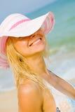 Tanned girl at sea beach Stock Photos