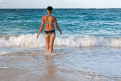 Tanned girls is standing in bright blue ocean Royalty Free Stock Photo