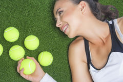 Tanned Happy Female Sportswoman Lying on Artificial Grass Surfac Royalty Free Stock Images