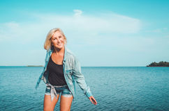 Tanned healthy middle aged woman with denim clothes having fun. Active, enjoy concept on sunny summer day, outdoors Royalty Free Stock Images