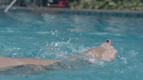 Lady with long legs and beautiful manicure splashes in water stock footage