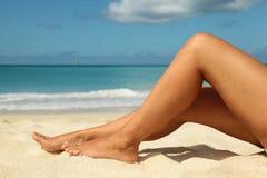 Tanned legs on the beach. Tanned legs on the caribbean beach stock photos