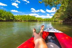 Tanned legs on kayak Stock Image
