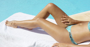Tanned legs of a young woman sunbathing Royalty Free Stock Image