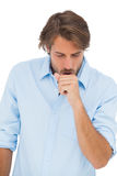 Tanned man coughing Stock Image