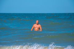 Tanned man swimming in the sea, vacation.  Stock Photography