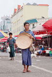 Tanned man walks on a local market, Ruili, China Royalty Free Stock Image