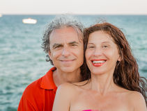 Tanned mature couple smiling Royalty Free Stock Photo